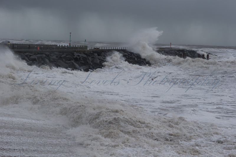 West Bay, Bridport, Dorset, United Kingdom on Saturday 8th February 2014 at 13:35hrs.  Huge waves crash into the harbour at West Bay during a ferocious storm as yet another frontal system brings gale force winds to the UK.