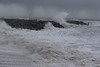 West Bay, Bridport, Dorset, United Kingdom on Saturday 8th February 2014 at 13:35hrs.  Huge waves crash into the harbour at West Bay during a ferocious storm as yet another frontal system brings gale force winds to the UK. Credit:  Living Levels Photography/Alamy Live News