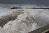 Waves pound the sea front at West Bay