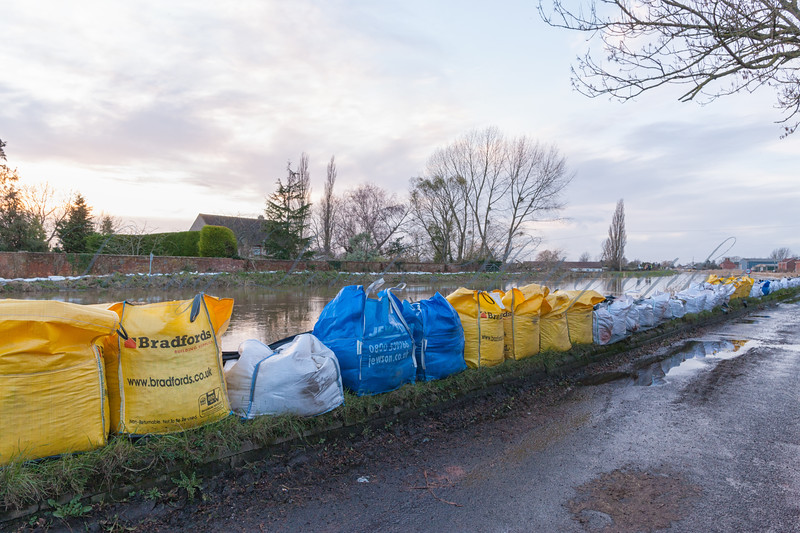 Sand bags are placed to defend houses at Burrowbridge