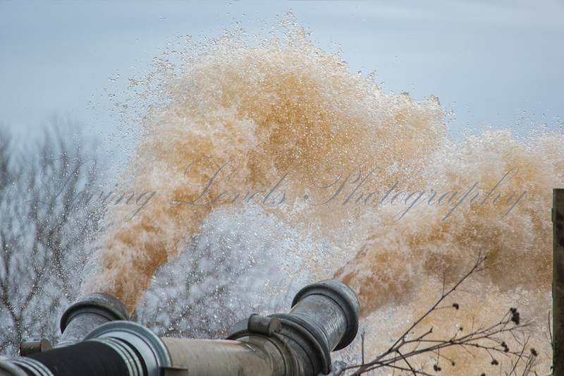 Pumping water from the flooded Somerset Levels at Burrowbridge into the River Parrett follwoing ongoing heavy rain.