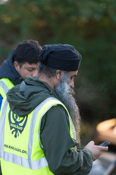 Volunteers from Khalsa Aid help with flood defense and rescue work