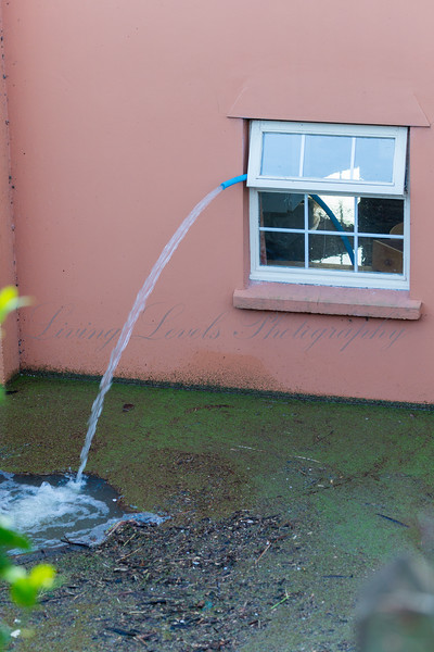 Flood water is pumped out of house at Burrowbridge