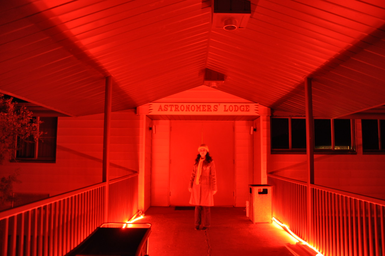 The astronomer's lodge is lit with red lights to keep down the light pollution.  Eva looks kinda spooky here!