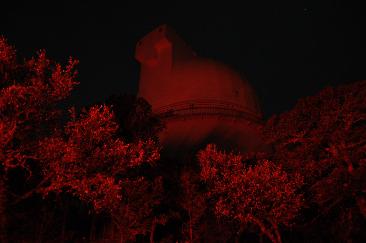 The observatory glowing in the astronomer's lodge red light