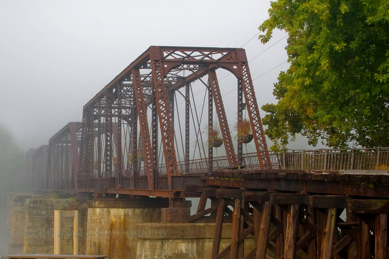 This foggy morning shot captures the old train bridge which is now a walking trail linking the west side with downtown Marietta.