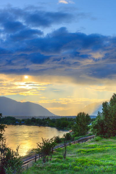 Rain, Sun, and Clouds over the Clarksfork River near Plains Montana - Portrait
