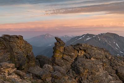 Long's Peak in the distance, framed by rocks in Rock Cut.