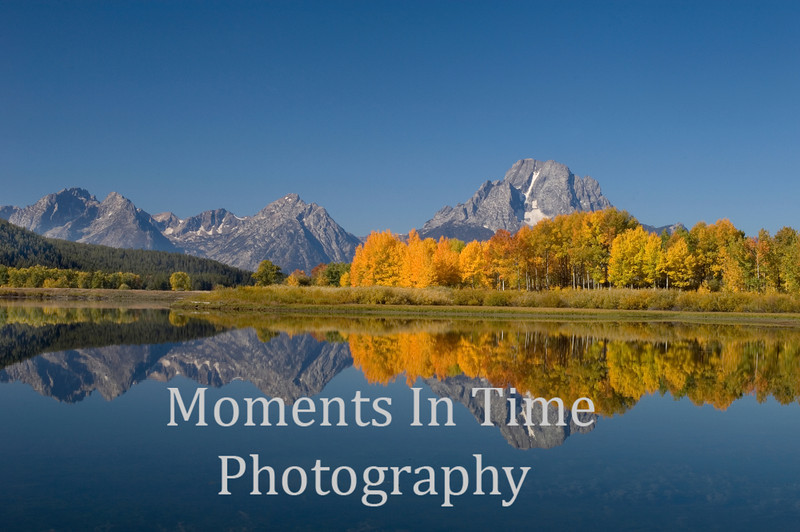 Tetons reflected at Oxbow bend