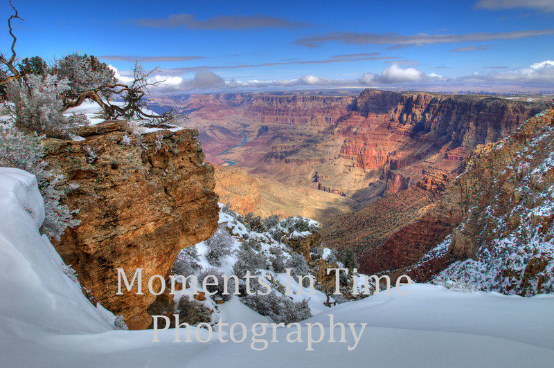 snow on rim, river in distance