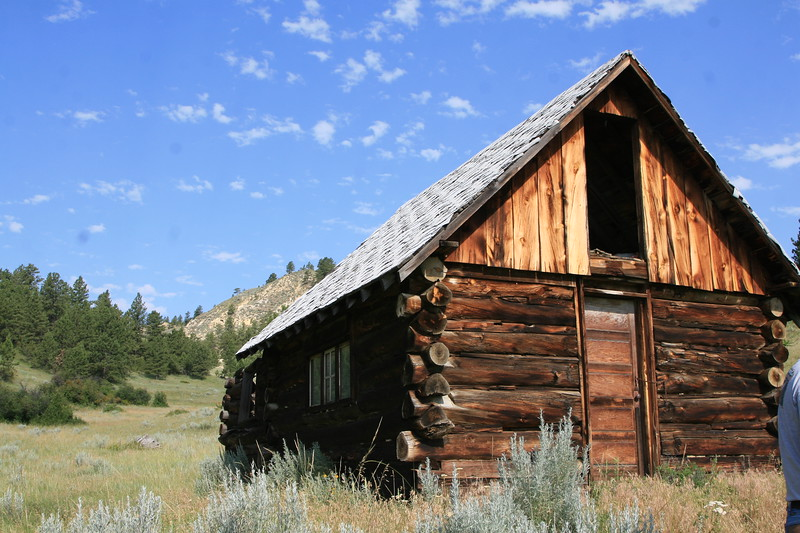 Old log cabin in the mountains