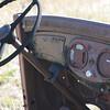 Vintage vehicle sits rusting away in a hayfield