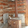 Antique cook stove in old log cabin