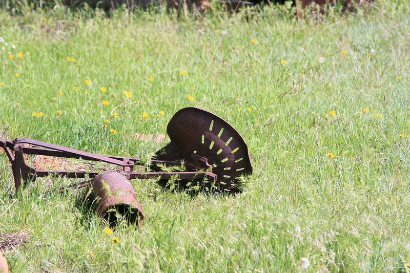 Antique farm equipment seat on the mountain side