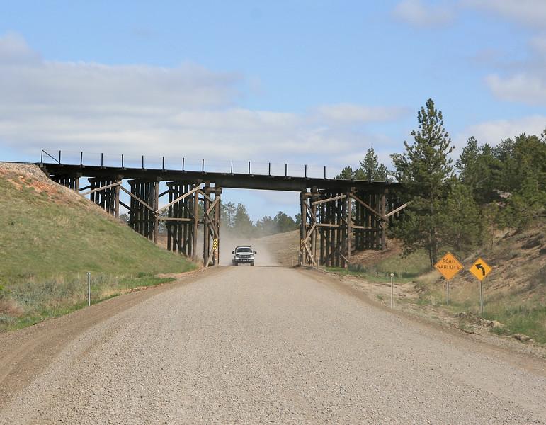 Mountain gravel road and bridge