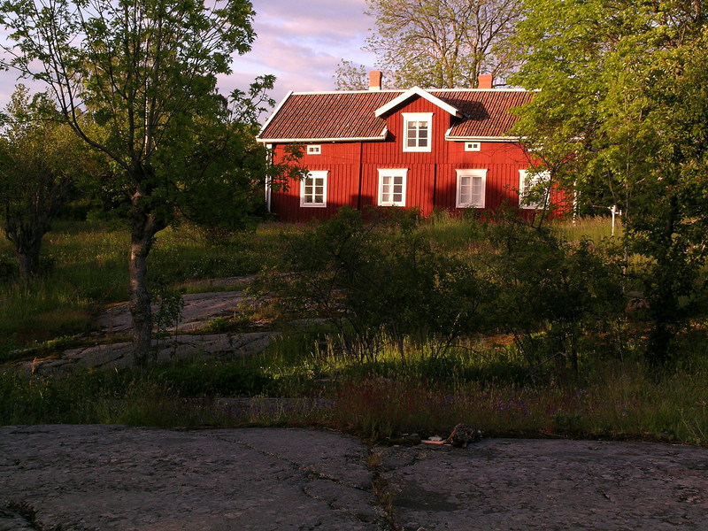 Granite outcrop and house, Aland Islands, Finland.