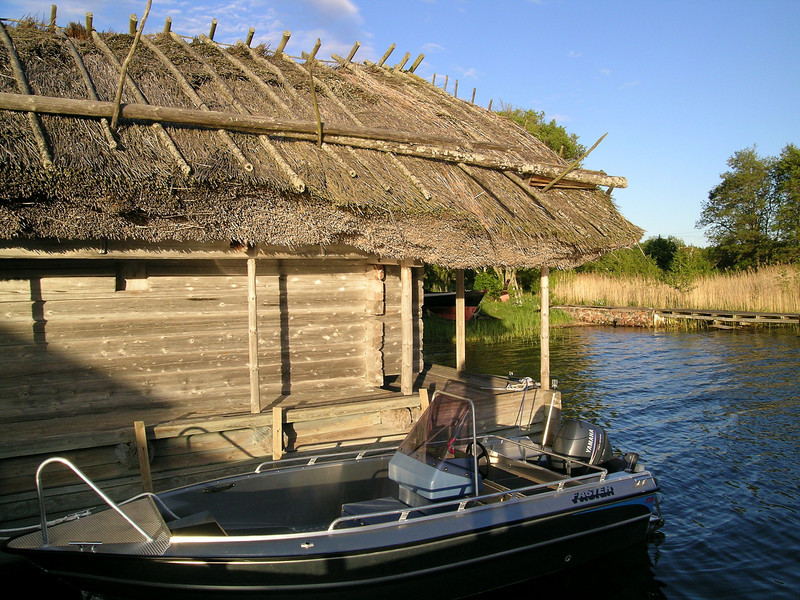 Old boathouse, new boat.  Aland Islands, Finland.  Note the roof made from stems of the same marsh reeds growing in the background.
