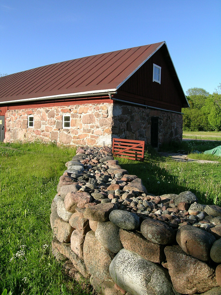 Åland Islands, Finland.  This is the only stone wall of this type that I've ever seen, where the outer walls are large rocks surrounding a core of small stones.