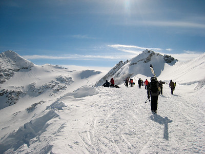 On the short hike up to the top of Blackcomb Glacier, a popular destination on this sunny day.  A few hardy soulds are continuing much further: see the trail of people and footprints at centre-left.
