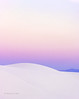 Dawn, white dunes and mountains
