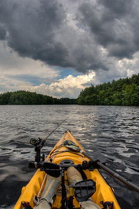 20120623. Storm approaching from behind on Whitehall Reservoir, Hopkinton MA.  The Hobie Adventure kayak is an ideal platform for fishing and photography.  Taken with Nikon D90 and 16-mm fisheye Nikkor lens.
