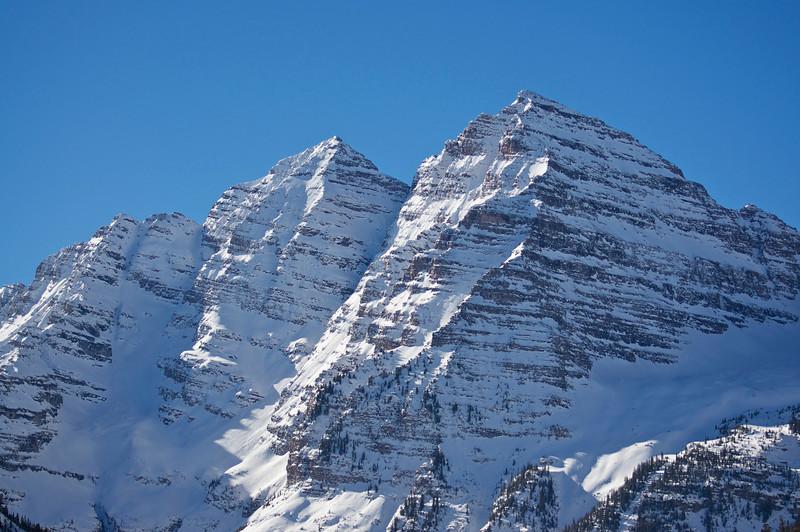 Winter snow blankets the Maroon Bells; Colorado Elk Range.