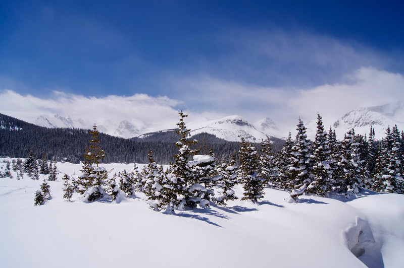 Late spring storms blow in over the snowy landscape at Brainard Lake; Colorado Indian Peaks Wilderness.