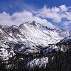 Cold spring winds blow across Longs Peak's northwest face; Rocky Mountain National Park, Colorado.
