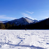 Admiring Longs Peak while taking a stroll across frozen Bear Lake in December; Rocky Mountain National Park, Colorado.