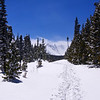 Snowshoeing down from Brainard Lake ahead of a late spring storm over the Indian Peaks, Colorado.