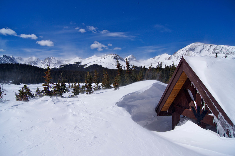 Spring snowdrifts engulf the shelter at Brainard lake; Colorado Indian Peaks Wilderness.