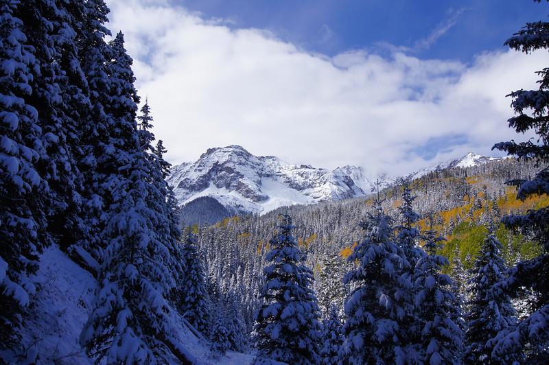 A snowy autumn landscape on the Blain Basin trail; Mt. Sneffels Wilderness, Colorado.