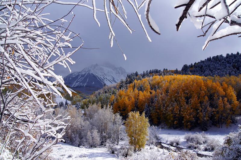 An autumn storm moves in along Dallas Creek beneath Mount Sneffels, Colorado San Juan Mountains.