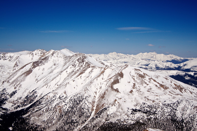Mt Massive (foreground), Colorado's 2nd highest peak, and Mount of the Holy Cross (far right background), viewed from the summit of Mt. Elbert in early March.