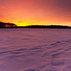Frozen Sunset<br /> Sunset from the ice of a frozen Lake Massabesic<br /> January 2010<br /> I didn't do anything to the colors in post.  This is how it looked.  Most spectacular sunset I've seen yet.