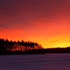 Welcoming Night<br /> Sunset from the ice of a frozen Lake Massabesic<br /> January 2010<br /> I didn't do anything to the colors in post.  This is how it looked.  Most spectacular sunset I've seen yet.