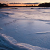 Sunset on Lake Massabesic not far from the shot from last year, but very different.  I really like the ice in this one.