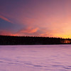 At the End of Our Day<br /> Sunset from the ice of a frozen Lake Massabesic<br /> January 2010<br /> I didn't do anything to the colors in post.  This is how it looked.  Most spectacular sunset I've seen yet.