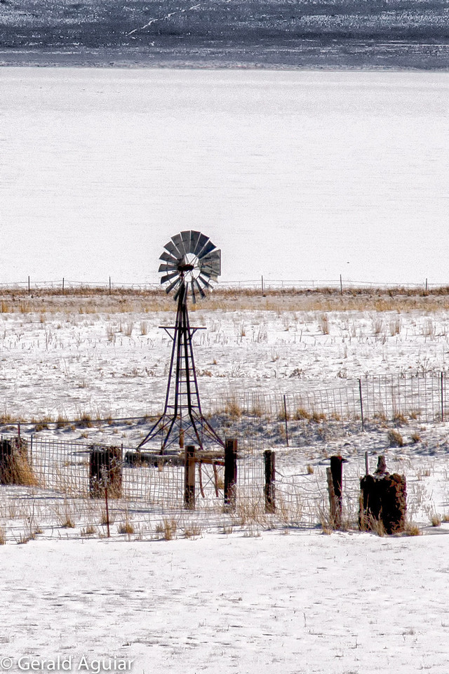 There were numerous windmills which appear to still function between Cedarville and Fort Bidwell.  The top half of the photo represents a small portion of Upper Alkali Lake covered with snow.  This windmill is about 1/4'th mile from the road.