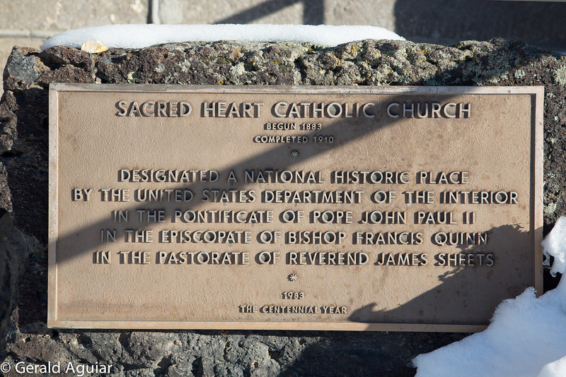 Dedication plaque outside the church.  As the plaque notes this church was begun in 1883.