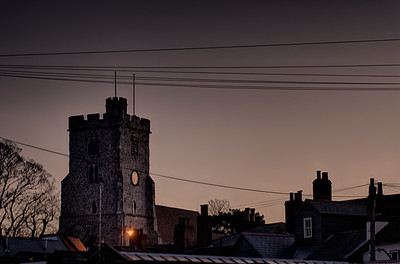 Dawn silhouetting the roof tops and Holy Trinity church in Rayleigh