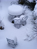Deep snow on garden chairs