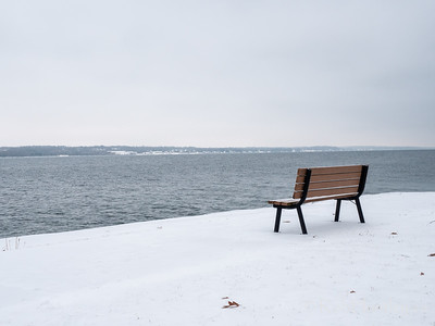 Winter bench on the St. Lawrence River