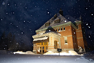 Heavy snow falls around a well lit and historic Courthouse in Fernie, BC
