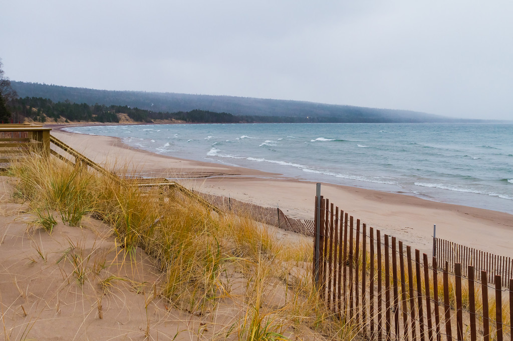 Snow clouds in the distance over Great Sand Bay.