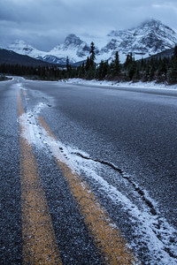 'Taking it back' - the ashphalt of the Icefields Parkway can't keep up with the quietly forces of nature. It feels as cold as the image looks today -33 this morning when I left for shooting!