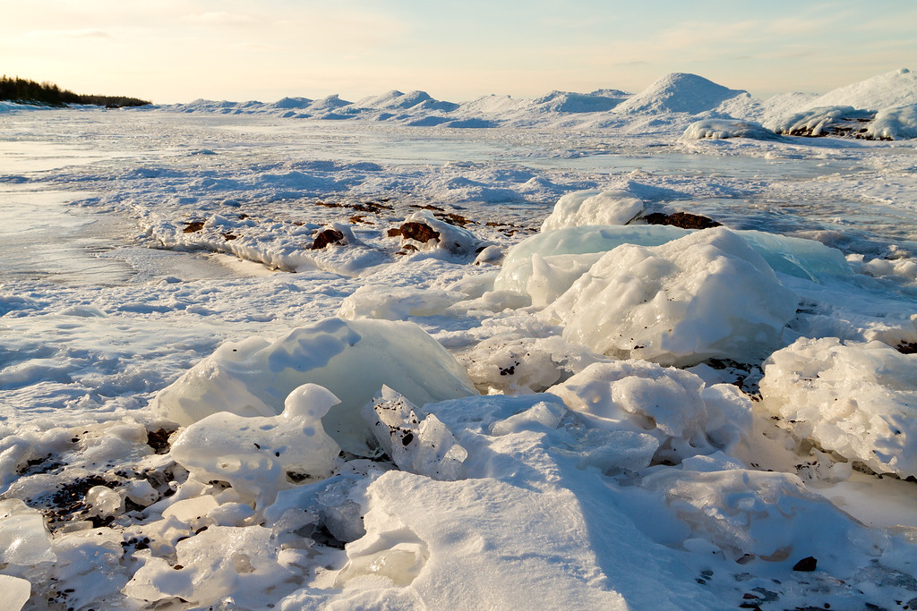 Ice covers rock along the shore of Lake Superior near Copper Harbor.