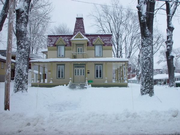 Ninteenth century french-canadian house with an open all around porch on boul.Gouin,Montreal.