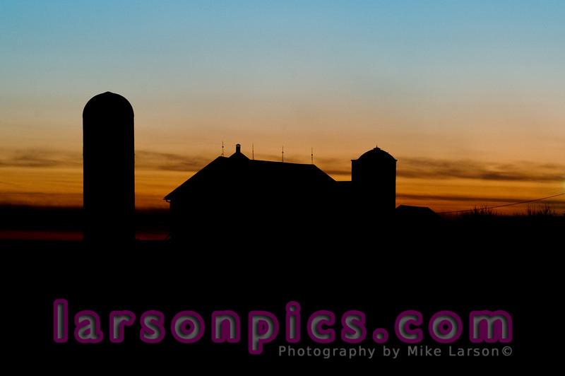 Farm or Barn at Sunset.