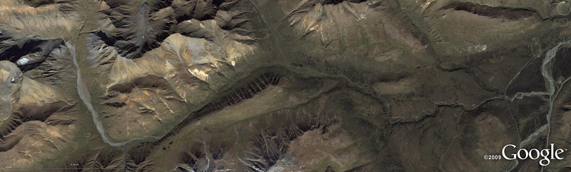"<span style=""color:#ff0000;""><strong>WoGE #169</strong></span></p>  The focus of Lost Geologist's inspired  <a href=""http://lostgeologist.blogspot.com/2009/08/where-on-google-earth-168.html"">WoGE#168</a> was the Paleozoic mercury deposit from Almaden, one of the largest (and perhaps weirdest) geochemical anomalies on Earth. My intuition to look in Spain was right (well, I admit, there was some reason involved, too), yet I needed couple of hours to find the spot. I'm not sure how many (if any) WoGE enthusiasts are navigating the web these days, so it's hard for me to tell whether I won a competition or was playing alone. In any case, I'll figure this out soon after posting this nice wide-angle view of something I believe worth to enter the WoGE hall of fame. Yeah, I just realized the beauty of GE running on twin screens, and even if it makes the challenge too easy by revealing perhaps too much, I still thing this spot is worth a double-wide view (you can choose to download various sizes of the picture, including the original, which is 3352x1007 pixels). The rules are the same, locate the view (lat, long) and describe it in geological terms. There is a major geological attraction here, to win, one must at least name it. This is a free run, good luck!"